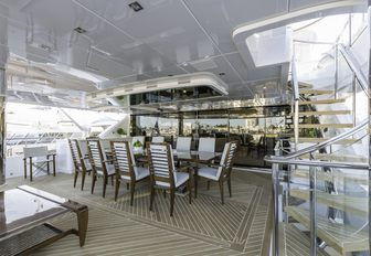 alfresco dining area on the upper deck aft of superyacht 'King Baby'