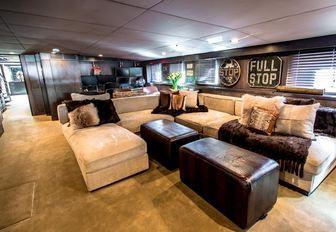 urban style main salon aboard charter yacht 'Plan B'