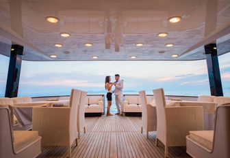 Man and woman enjoying the living area on charter yacht ANDREA