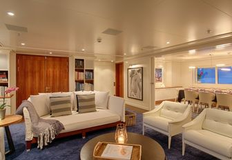 stylish main salon with lounge on board expedition yacht SENSES