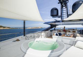 jacuzzi, seating and bar on the sundeck of luxury yacht Irisha