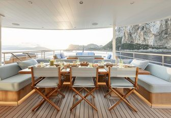 Covered outdoor dining area on explorer yacht 'Blue II'