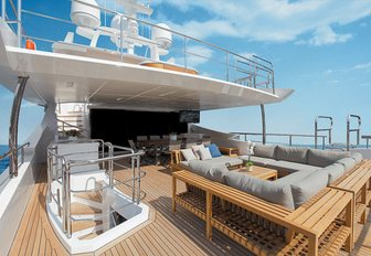 chic lounging area and alfresco dining option on upper deck aft of charter yacht Cheers 46