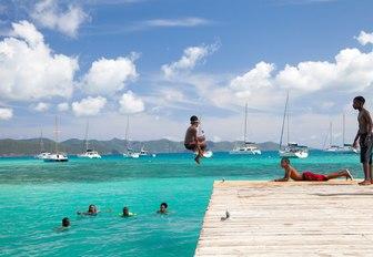 People jumping into sea in US Virgin Islands