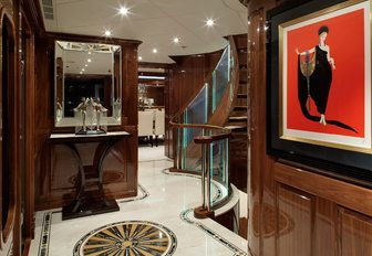 marble-floored hallway with rich high-gloss wall panels on board motor yacht Remember When