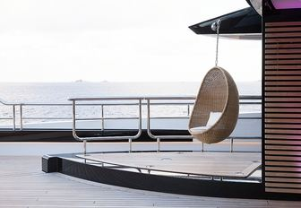 hanging chair on the uncluttered deck aboard motor yacht KISMET