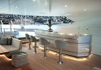 bar, seating and Jacuzzi on the sundeck of luxury yacht ARADOS