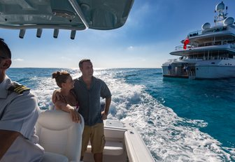 Couple on tender with Superyacht BACA in background