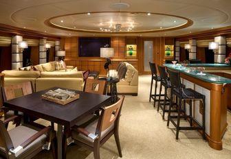 Main Salon with bar on superyacht EROS