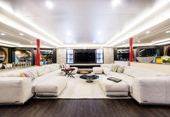 contemporary styled salon with huge sofas on board charter yacht SALUZI