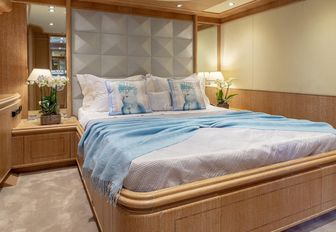guest cabin with blue bedding in luxury charter yacht ANAMEL