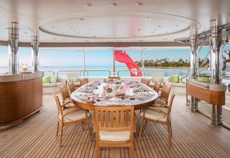 al fresco dining area on the upper deck aft of charter yacht CALYPSO