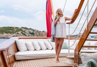 Woman relaxes on the deck of superyacht Haida 1929
