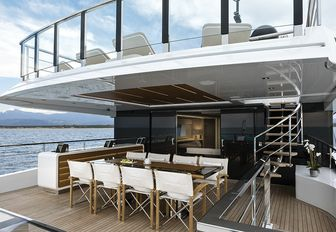 the upper aft deck of charter yacht EVA. 4EVA featuring alfresco dining table and plush dseating