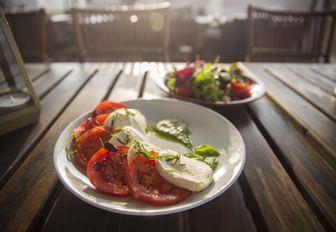 Salad on table in terrace area of Diablito, Yas Marina