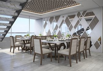 two dining tables seat 16 guests in total in the main salon of luxury yacht ELITE