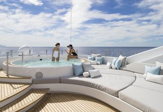 charter guests relax in the Jacuzzi on the sundeck of motor yacht TURQUOISE