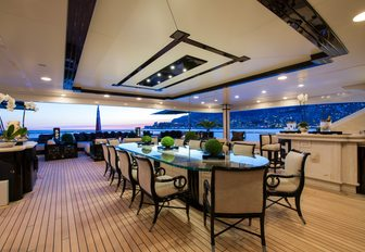 alfresco dining on the spacious upper deck aft of luxury yacht 'Lioness V'