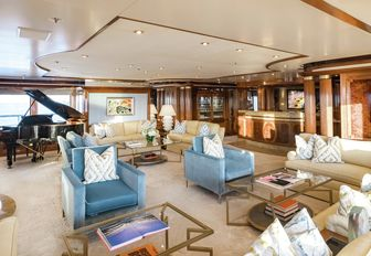 comfortable seating area and grand piano in the skylounge aboard motor yacht TITANIA