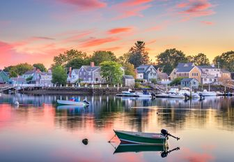 a dock in new england where everyone owns a motor yacht and spend their time on the water where guests on a  luxury yacht charter vacation destination