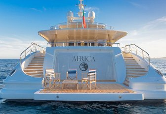 table and chairs on the swim platform of luxury yacht Africa I