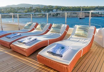 sun pads lined up on the sundeck of charter yacht Africa I