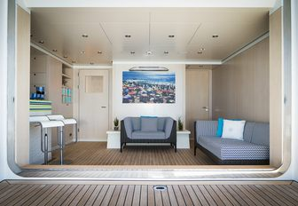 luxe beach club with lounge and bar aboard luxury yacht TITANIA