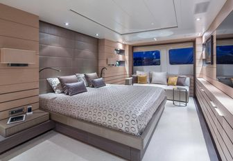 large bed in the master suite of charter yacht DYNAR