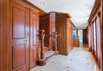 marble floored hallway with wooden wall panels on board motor yacht PRAXIS