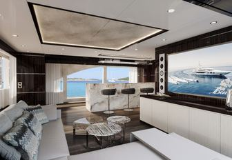 the main loung of charter yacht happy me with massive cinema screen and cocktail bar
