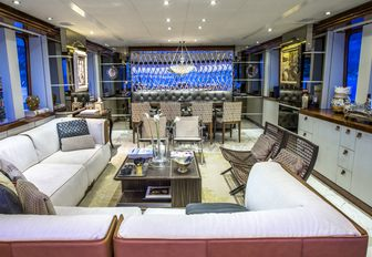 seating area and formal dining setup in the main salon aboard charter yacht Zulu
