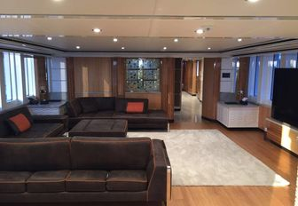 plush leather sofas and widescreen TV in the main salon aboard luxury yacht Code 8