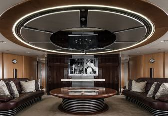 two brown leather sofas in the main salon of sailing yacht Maltese Falcon
