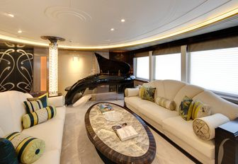 schimmel Pegasus piano with sofas in the piano lounge aboard motor yacht AMARYLLIS
