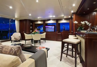 skylounge with bar, sofa and games table aboard charter yacht 'Pure Bliss'