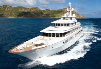 superyacht UTOPIA cuts through the water of a luxury yacht charter