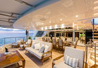 seating and al fresco dining areas on the upper deck aft of superyacht 'King Baby'