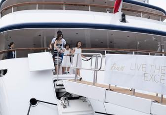 A family steps off a Benetti yacht at the Singapore Yacht Show
