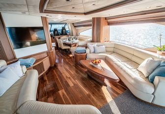 chess yacht main salon, with large tv screen and sofas with coffee table