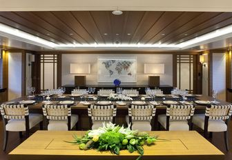 formal dining area with a large table in the main salon of luxury yacht Mary-Jean II