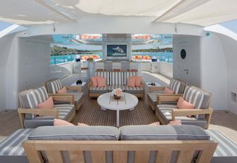 superyacht sundeck, with lounging area and tv screens