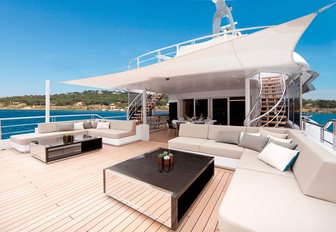 luxe deck area with seating and canopy on board luxury yacht Mogambo