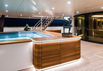 inviting swimming pool on the aft deck of luxury yacht Here Comes The Sun