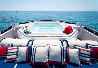Sundeck jacuzzi on superyacht ELEMENT with sunpads surrounding