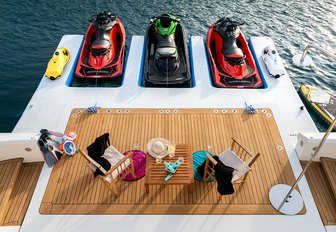 toys lined up on swim platform of charter yacht africa i