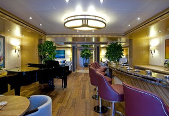 bar and piano in aft deck entrance aboard charter yacht 'Indian Empress'
