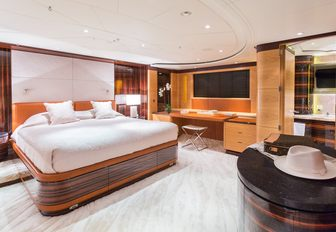 master suite with large bed on board charter yacht Q
