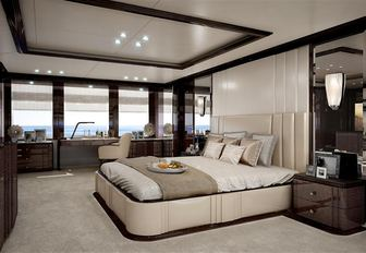 large bed in the classically-styled master suite aboard motor yacht Spectre