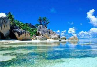 idyllic beach of the seychelles with boulders, white sands and clear waters