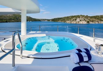 jacuzzi on yacht, with coastlines of croatia in background